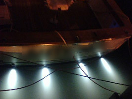 power boat with Dr. LED underwater light at night